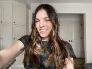 Kyla smiles into the camera